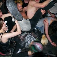 Stagediver lands on the crowd at Oi Polloi gig at the Boston Arms, Tufnell Park, London 2011