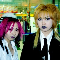 Punk style young women outside convenience store