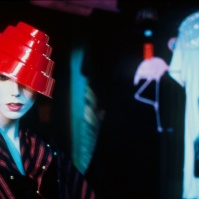 mannequin wearing 'Devo' style hat with pink flamingo and James Dean t-shirt in one of the alternative / retro / vintage clothing shops on or near St Mark's Place, New York City, USA, 1981 [photo © Ted Polhemus]