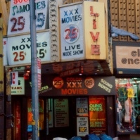 Porn movie theaters and garbage, 42nd Street, New York City, USA, 1984 [photo © Ted Polhemus]